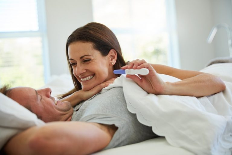 Shot of a mature couple feeling excited after taking a home pregnancy test